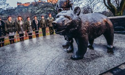 Edinburgh, UK - January 20, 2015. Polish scouts next stands in front of Wojtek the Soldier Bear Memorial in Edinburgh city
