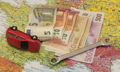 40274830 - map of europe, broken car and euro money. concept of safety car travelling around europe and insurance.