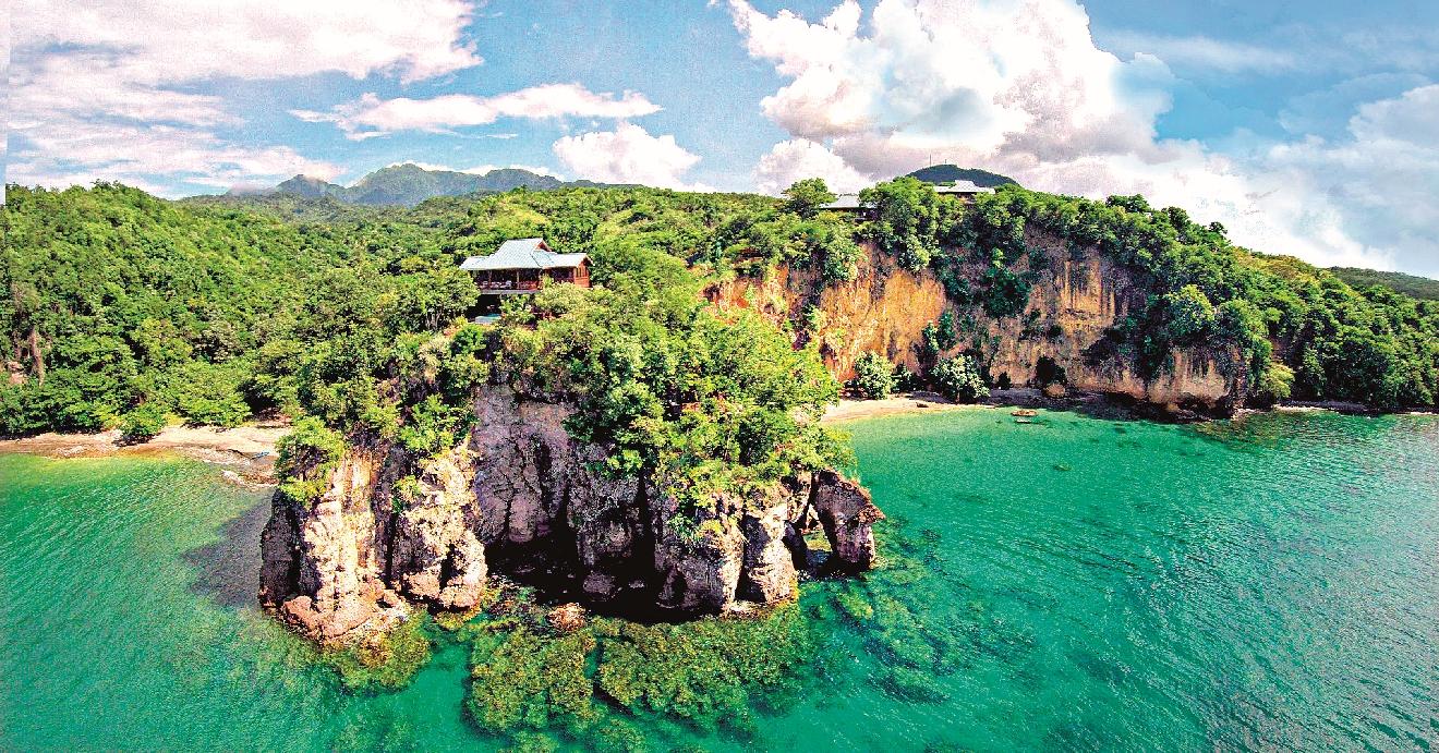 Ze stromových domků resortu Secret Bay budete mít neuvěřitelný výhled na oceán.