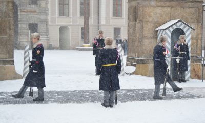 PRAGUE, CZECH REPUBLIC - FEBRUARY 23, 2013: Prague Castle during a heavy snowfall. Hourly change of the Guard of Honour.
